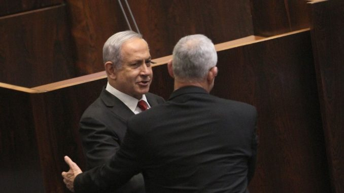 Netanyahu and Gantz shake hands