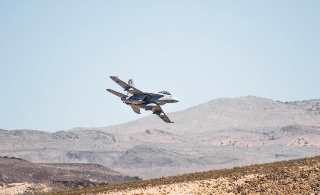 jet flies over hills as Israel and Iran inch closer to war