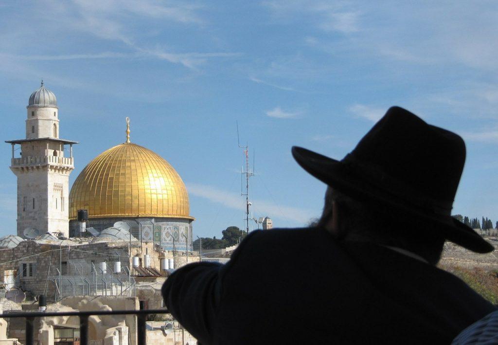 Jewish man watches Temple Mount