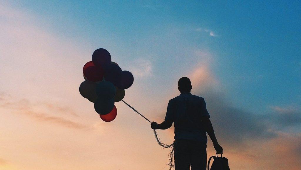 Man carrying balloons